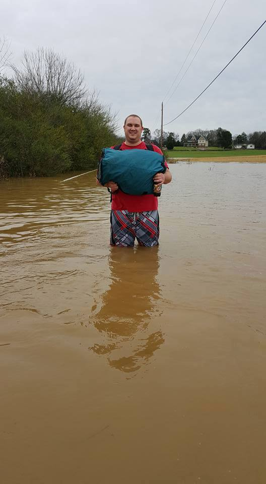 My nephew Jon wading out our flooded road to go to college.